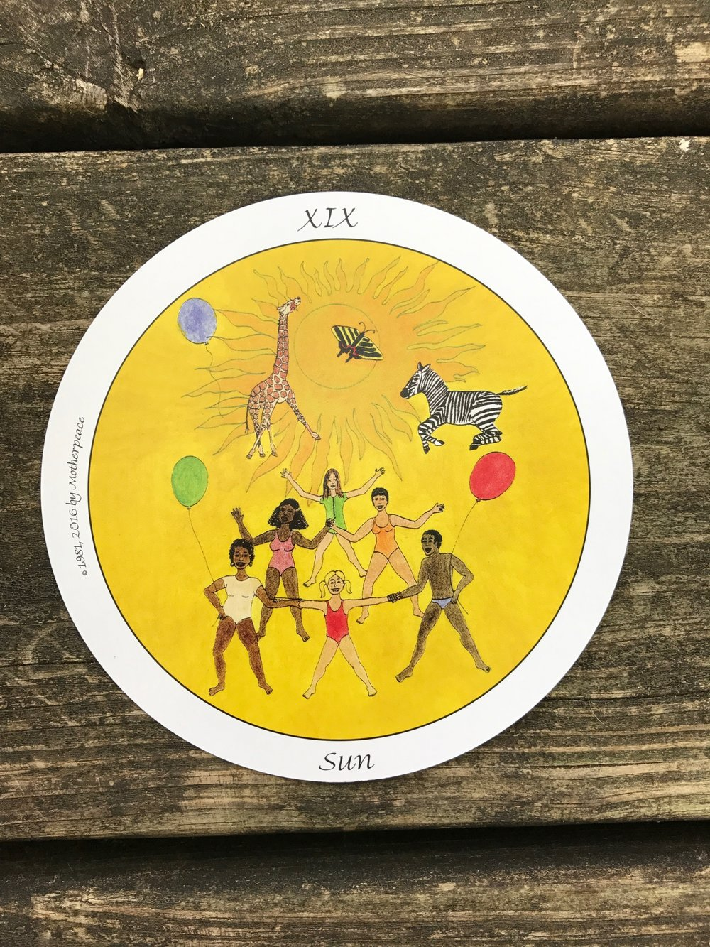 The Sun from The Motherpeace Tarot Deck