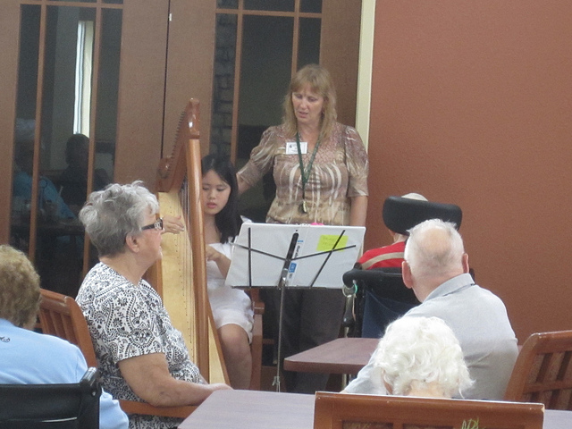 Paying the harp at Christan Community Home while Tia (the activites director) sings along.