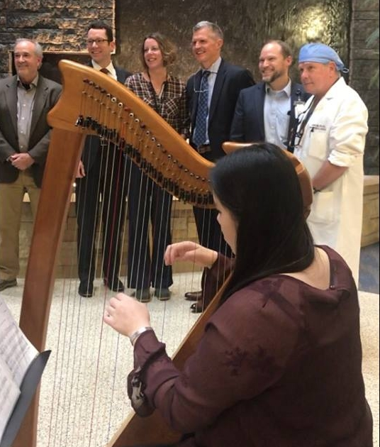 Playing the harp at United Hospital's Vascular Center for its 5th anniversary open house.