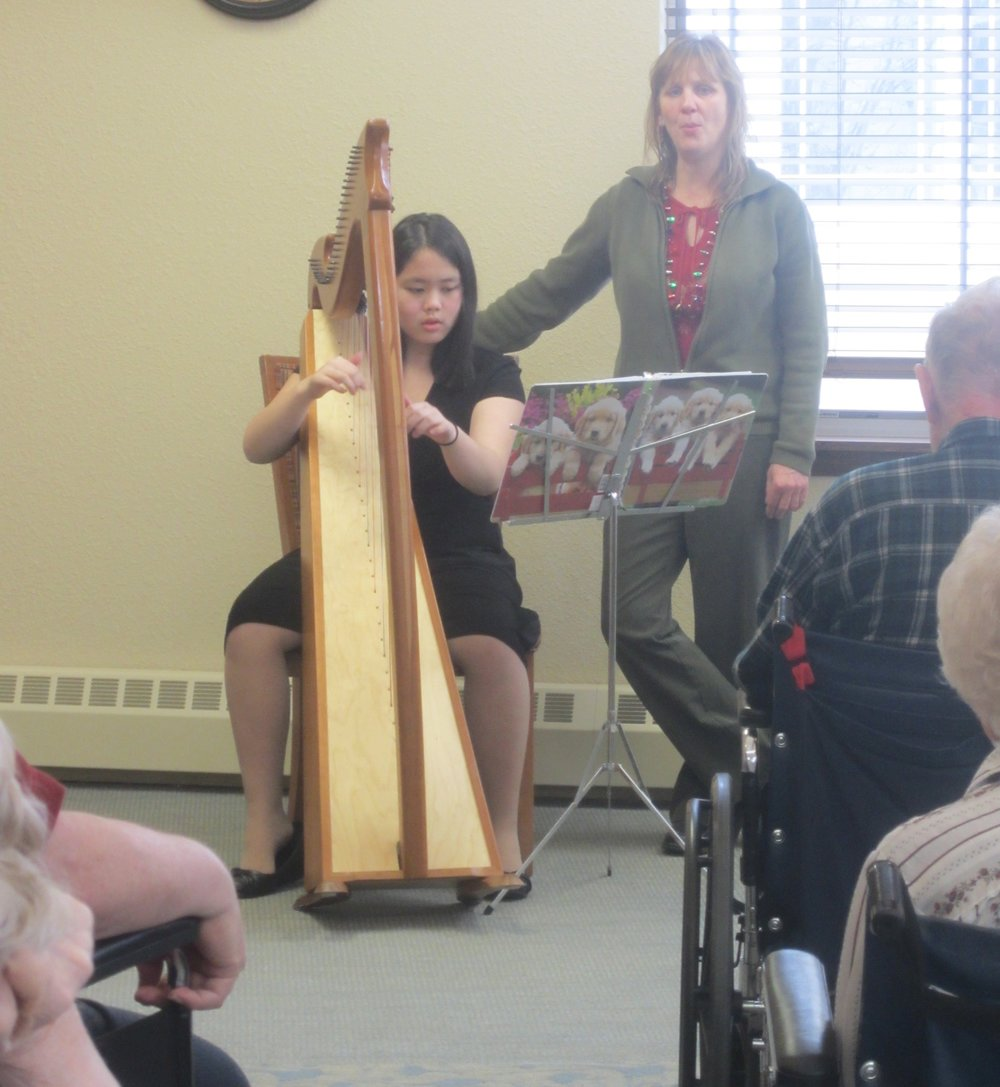 Playing the harp in Christian Community Home's chapel while Tia (the activities director) sings along.