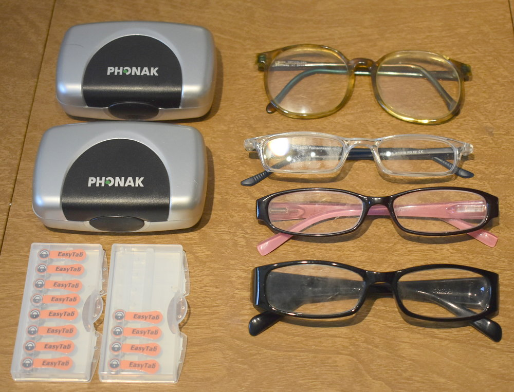 Eyeglasses, hearing aids, and hearing aid batteries that were collected at the June mini-One Stop Donation Drop for the Scandia-Marine Lions Club. The glasses and hearing aids will be refurbished and given to people in need throughout the U.S. and world.