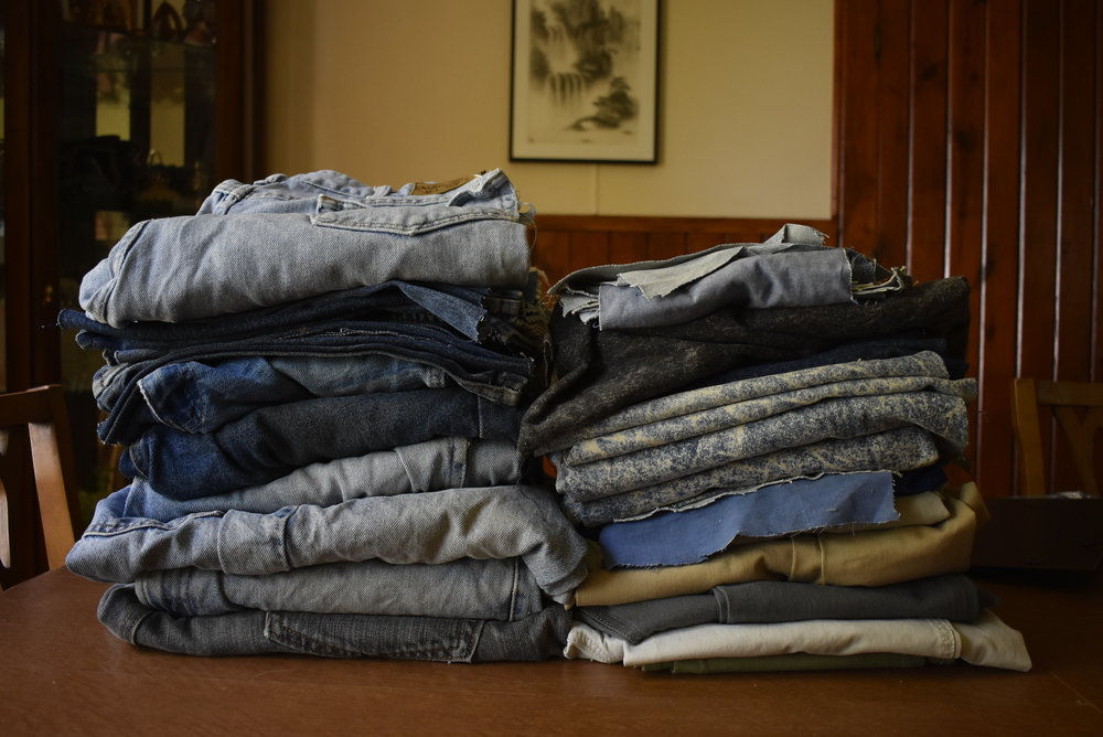 Jeans and pieces of jeans were collected on July 11, 2018, to be used to make shoes for children in Uganda. The shoes help prevent the children from getting jiggers - tiny insects that live in the dust and burrow into feet where they lay eggs. Jiggers can cause many health complications - including death. Repurposing these jeans into shoes literally can save lives!