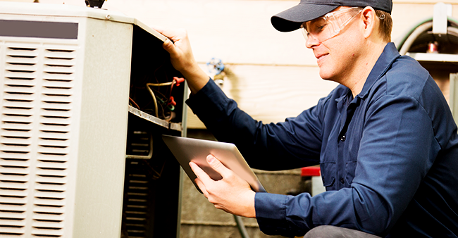 hvac technician with tablet.png