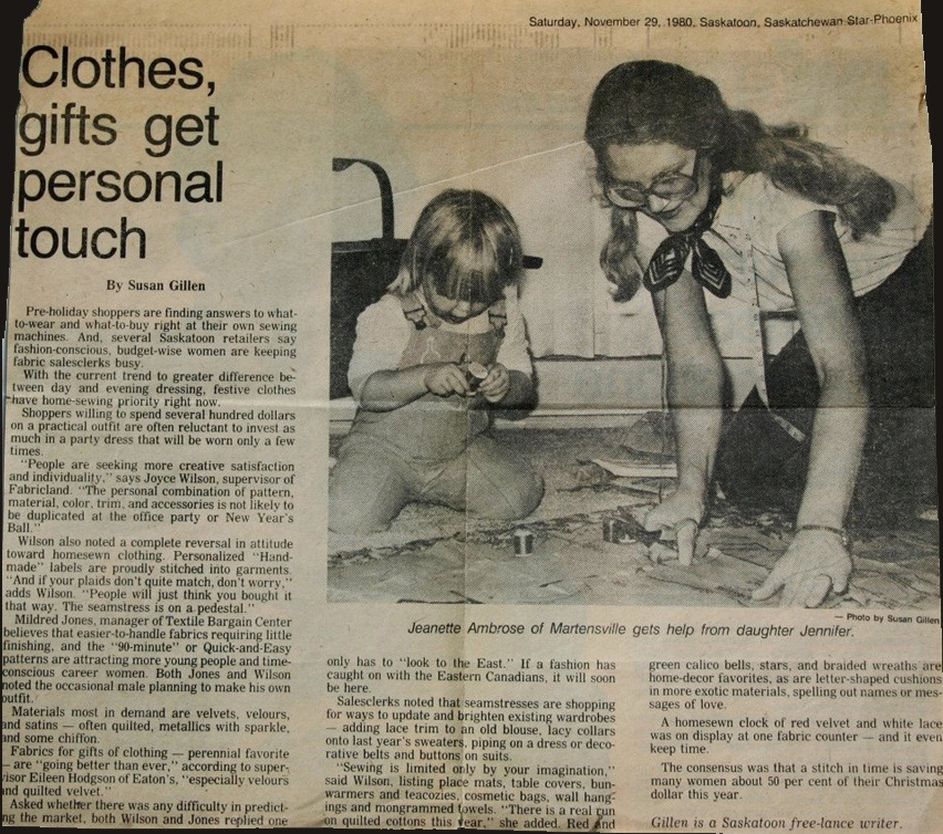Jenny at age 2 helping her mom sew.