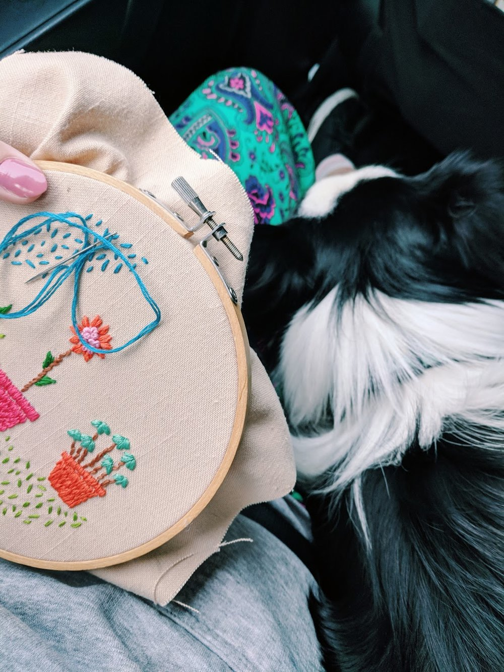 Embroidery is the best travel project. I have a little bag that I put all my threads, my needle and scissors in. With me is my travel buddy Finnegan of  @finneganswonderland  :)