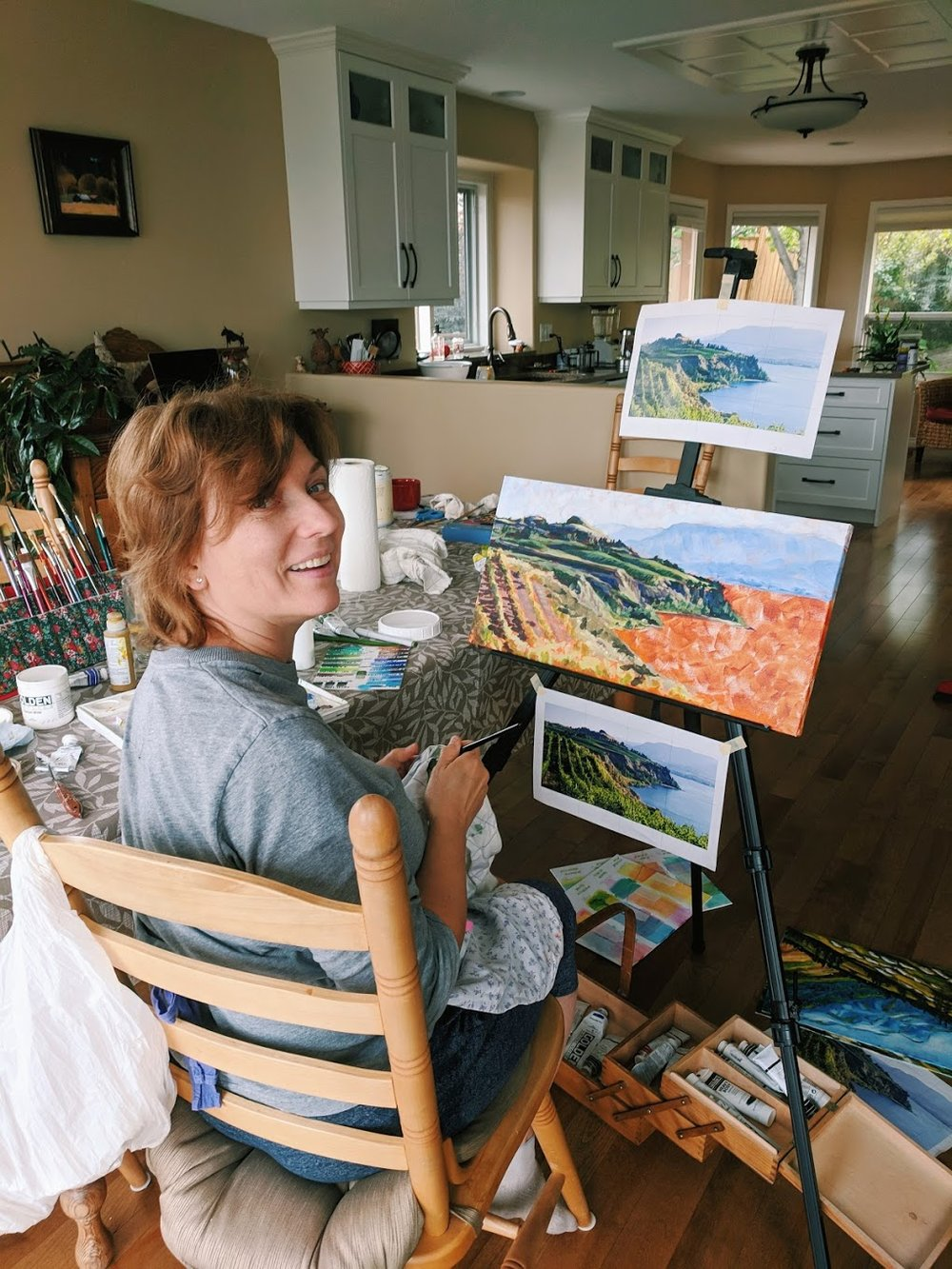 My mom working on her painting of a vineyard in the Okanagan Valley.