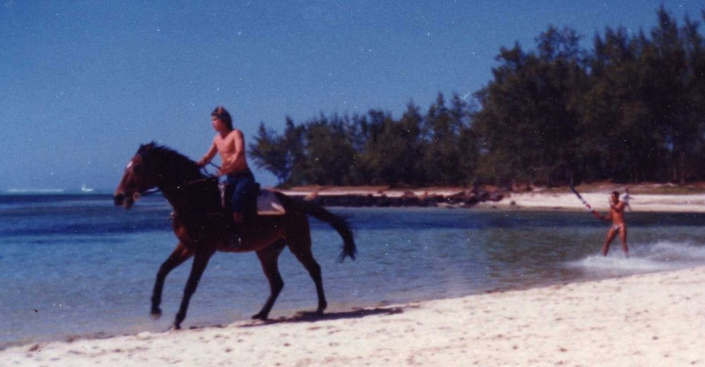 Water skiing behind a horse -