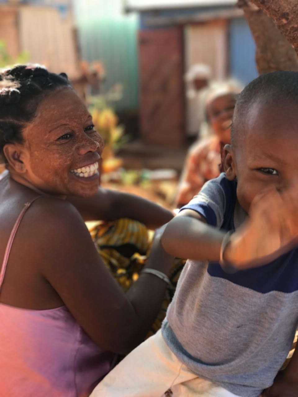 Child and her family in Diego Suarez, Madagascar.jpg