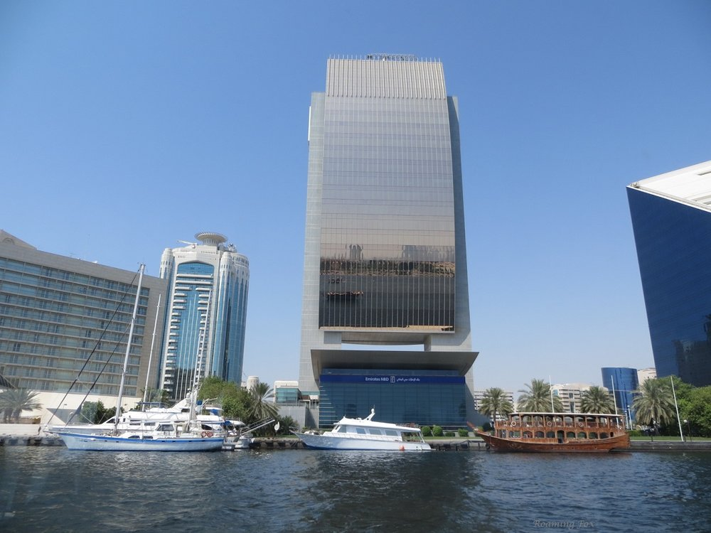 Contemporary architecture and boats with wooden Dhow Dubai Creek