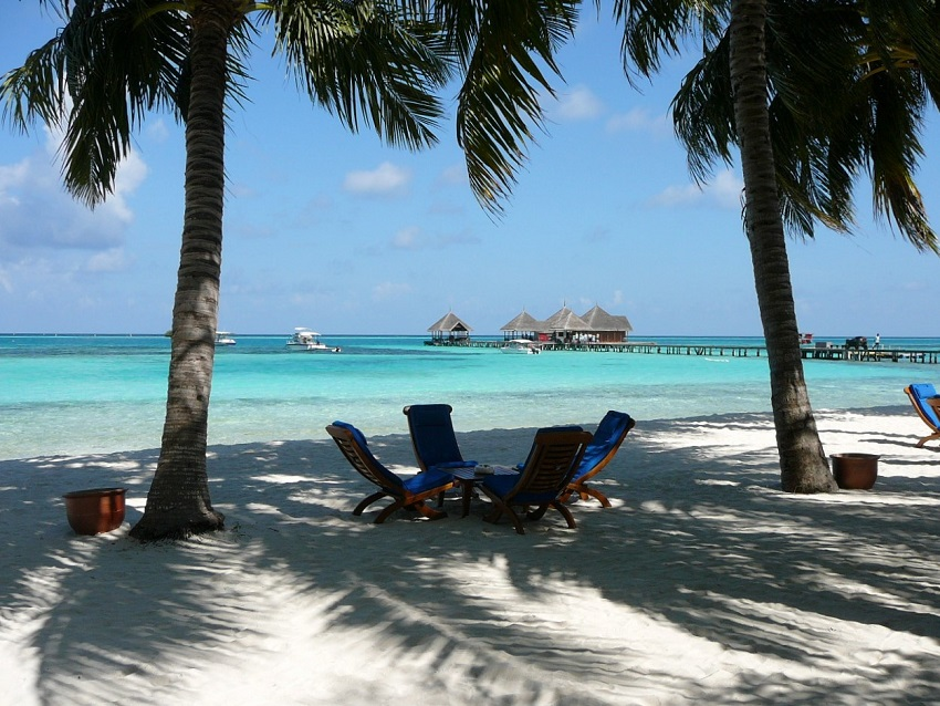 Beach chairs, palms, sea and jetty Club Med Kani.JPG
