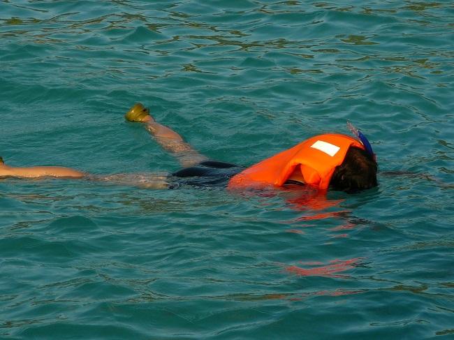 Snorkeler with life jacket Maldives.JPG