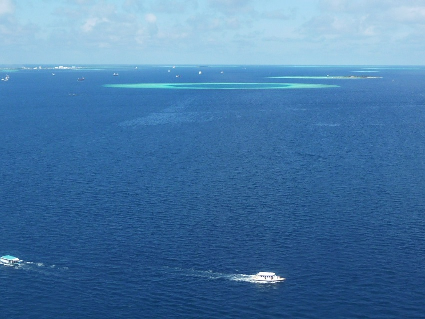 Boats, islands and lagoon from sky Maldives.JPG