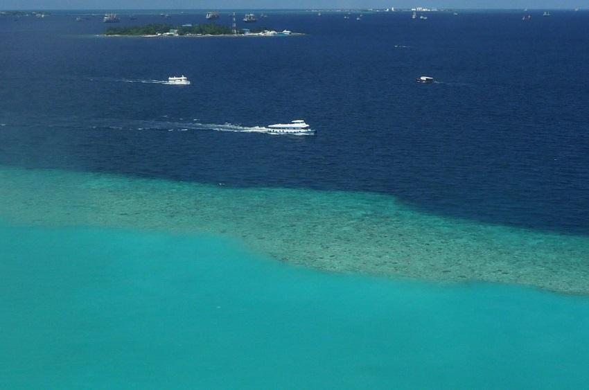 Lagoon, sea and boats from sky Maldives.JPG
