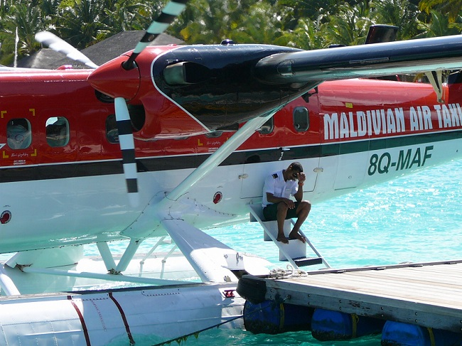Sea Plane & crew resting Club Med Kani Maldives.JPG