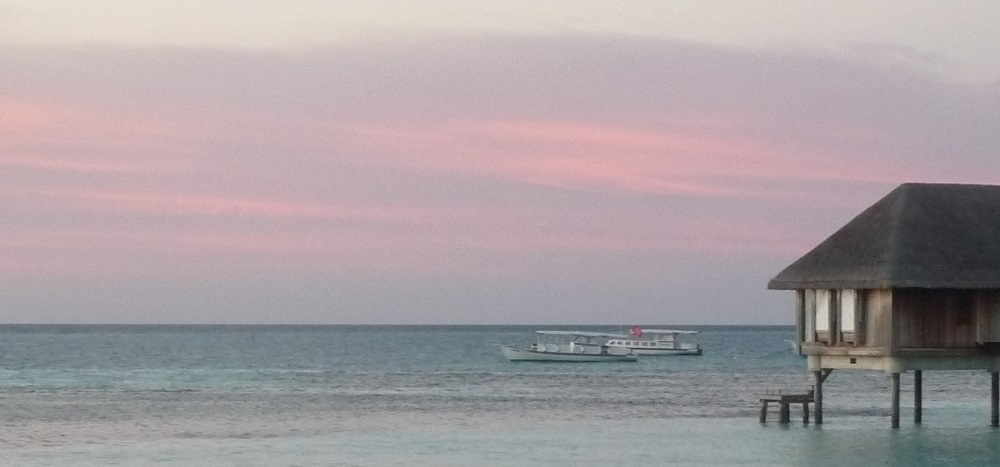 Sunset and boats near jetty Club Med Kani.JPG
