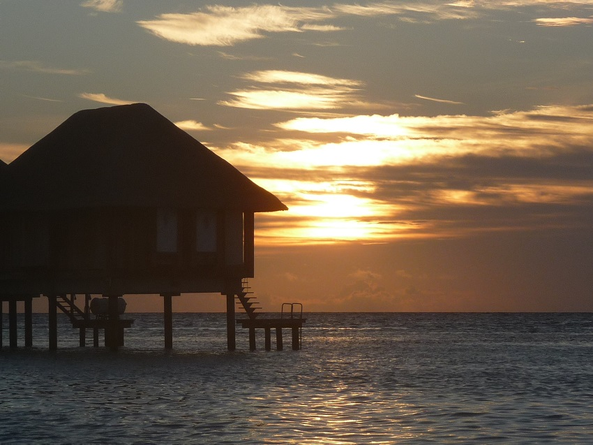 Sunset and water bungalows Club Med Kani.JPG