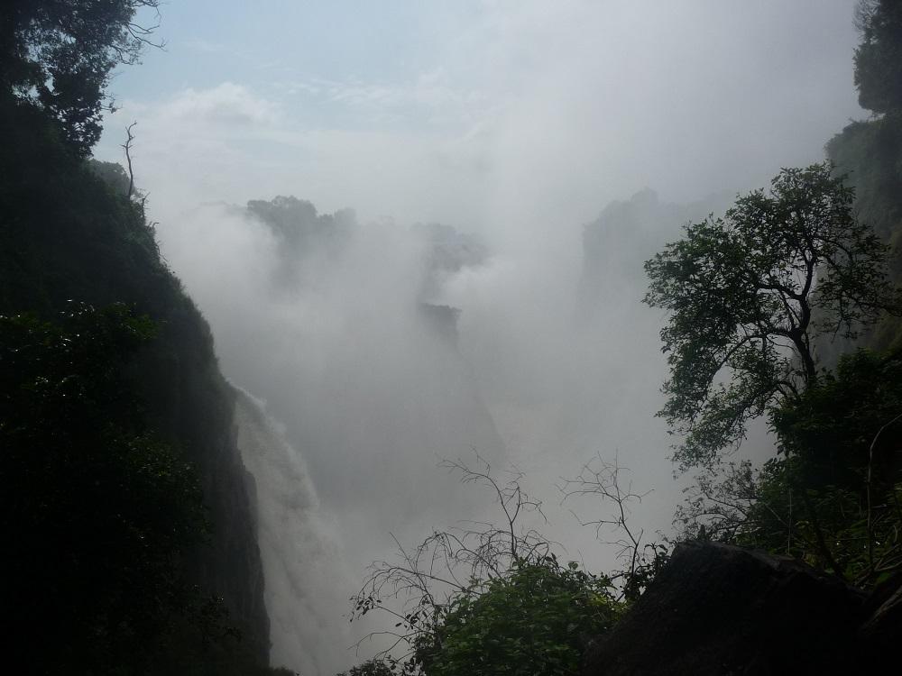 Mist from Victoria Falls hiding the falls.JPG