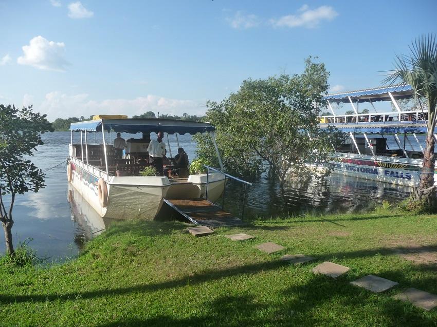 Boats for Sunset Cruise Zambezi river.JPG
