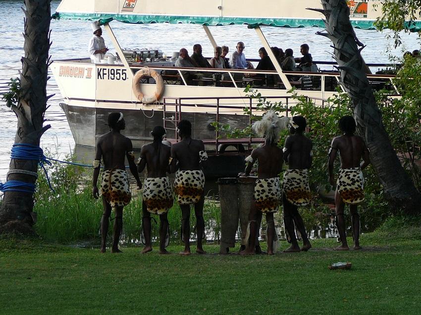 Traditional African dancers with departing Sundowner cruise Zambezi River.JPG