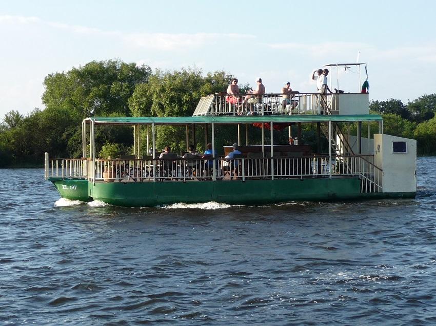 Green river boat cruising Zambezi river.JPG