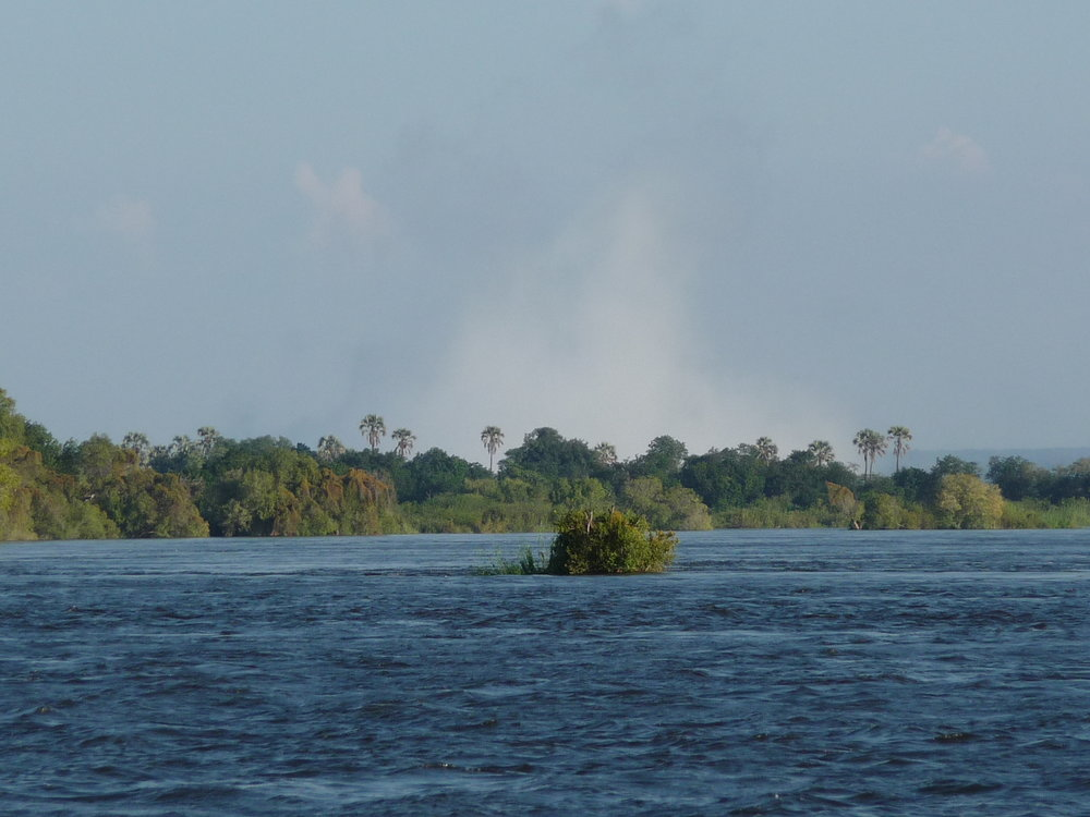 Mist of Victoria Falls in the distance.JPG