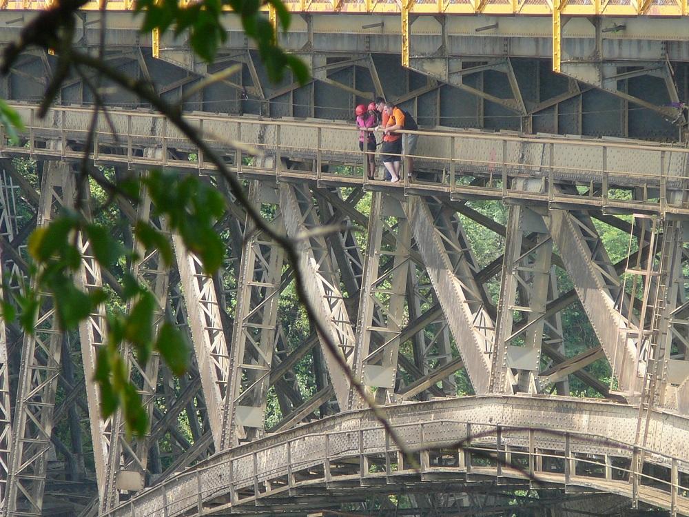 Bungee jumpers contemplating jumping off Victoria Falls Bridge.JPG