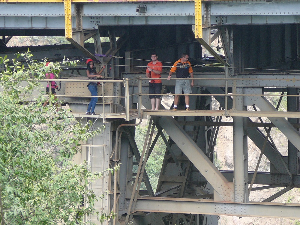 Bungee jumpers preparing to jump off Victoria Falls Bridge.JPG