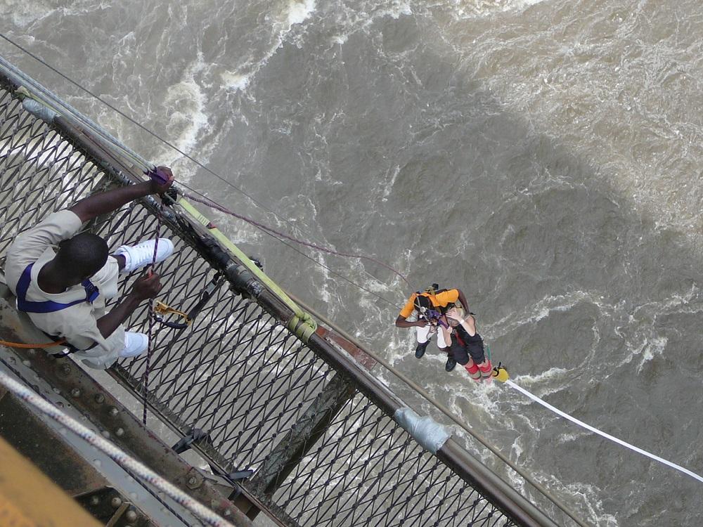 Bungee jumper dangling off Victoria Falls bridge.JPG