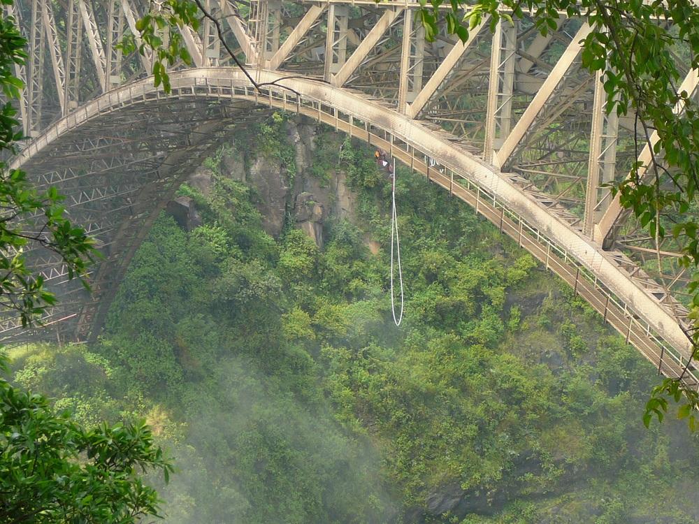 Victoria Falls Bridge and bungee jumper.JPG