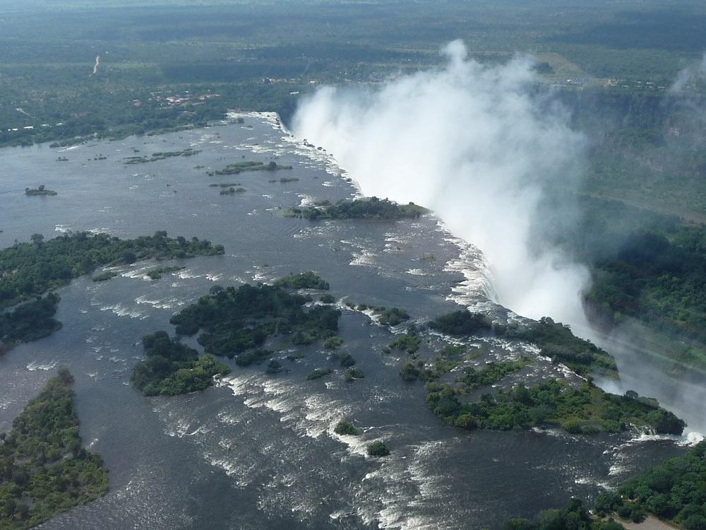 Zambezi flowing over falls and mist Victoria Falls