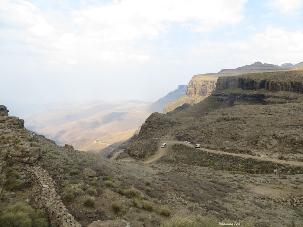 Vehicles driving down Sani Pass.JPG