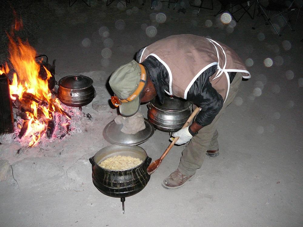 Stirring the food in cast iron pot.JPG