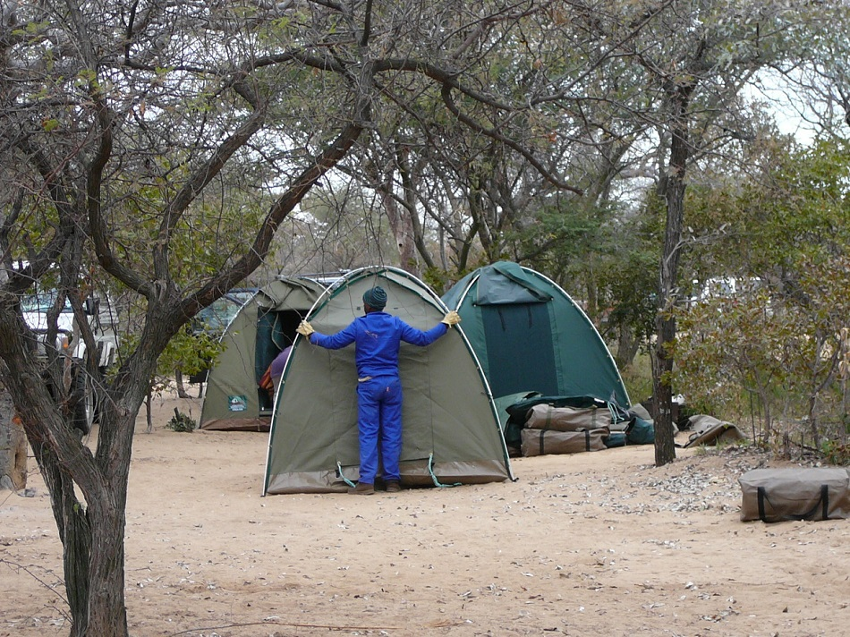 www.roaming-fox.com taking down tents.JPG