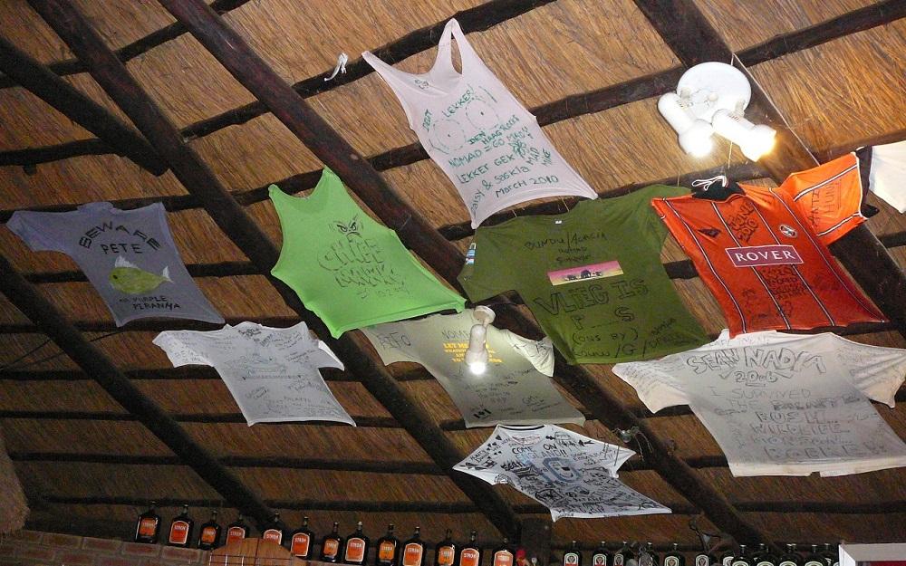 T-shirts in the bar at Camp Itumela, Palapye