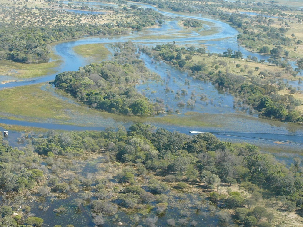 Boat in canal Okavango www.roaming-fox.com.JPG