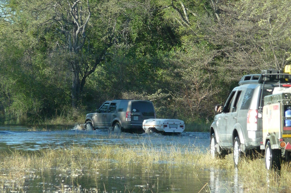 www.roaming-fox.com Okavango water and vehicles.JPG