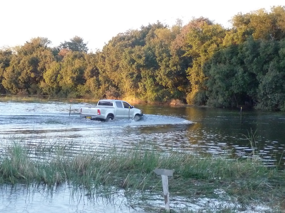roaming-fox.com demarcated area to drive through water Okavango.JPG