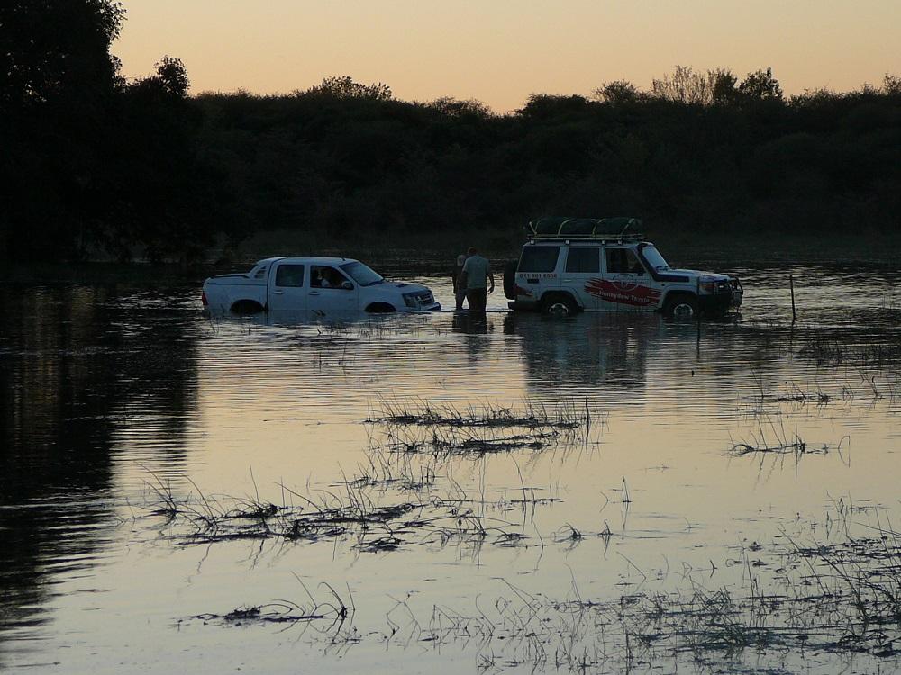 Towing vehicle through water Okavango Botswana.JPG