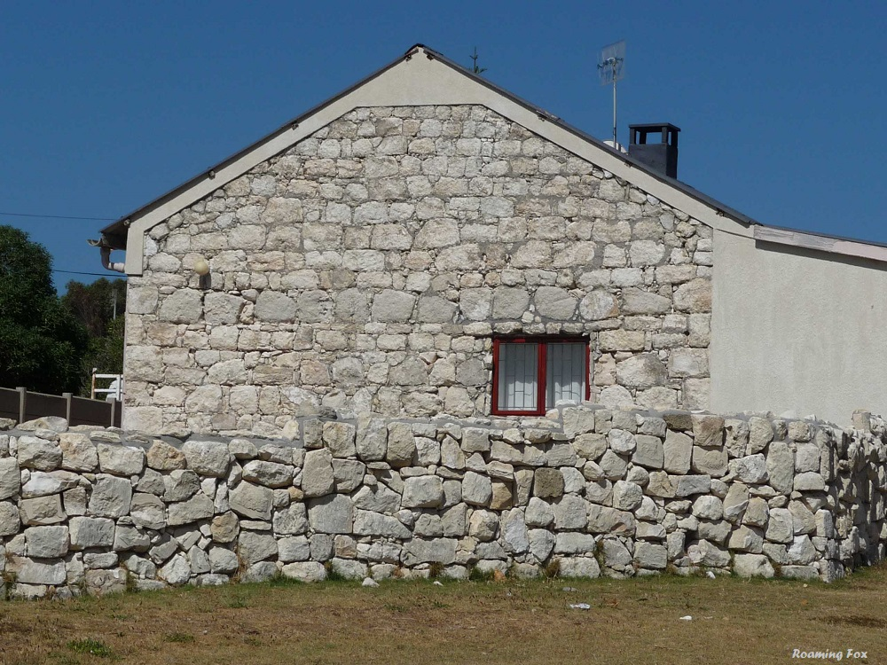 Traditional limestone building and wall Gansbaai