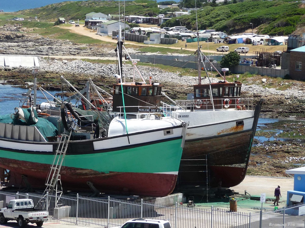 In the old harbour where wooden fishing trawlers are being maintained and repaired