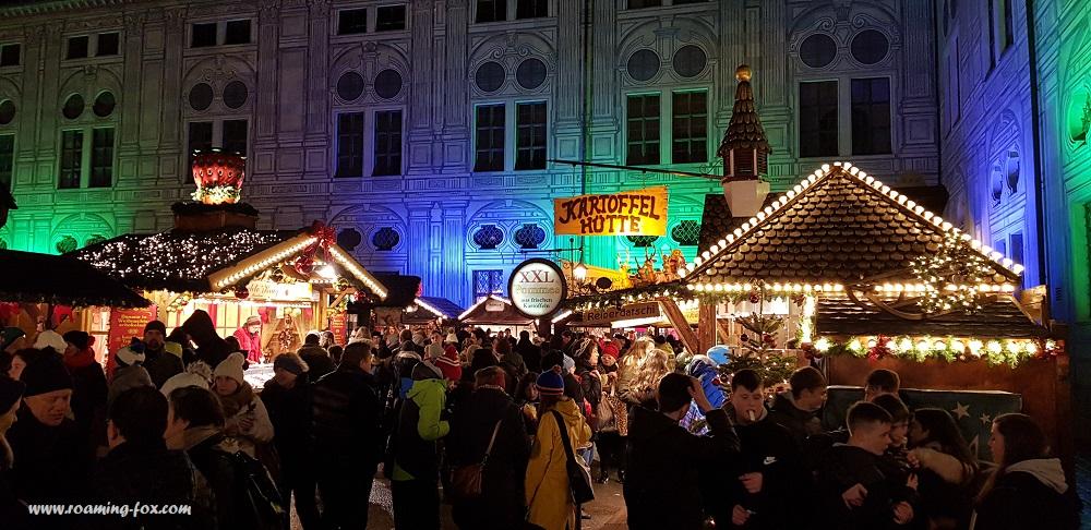 People gathered at Christkindlmarkt in Kaiserhof courtyard, Residenz Munich