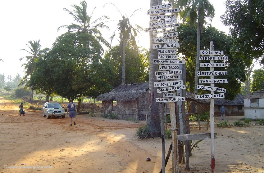 Red road or gravel road Morrungulo leading to a bakery that bakes pao, a traditional bread found in Mozambique