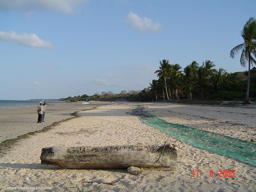 Beach at Vilanculos with pirogue and fishing nets