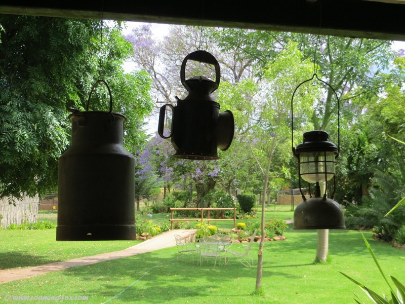 Milk can and lamps - garden decor