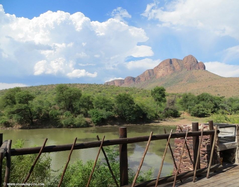 Tlopi tented camp - safari tents overlooking the dam and mountain
