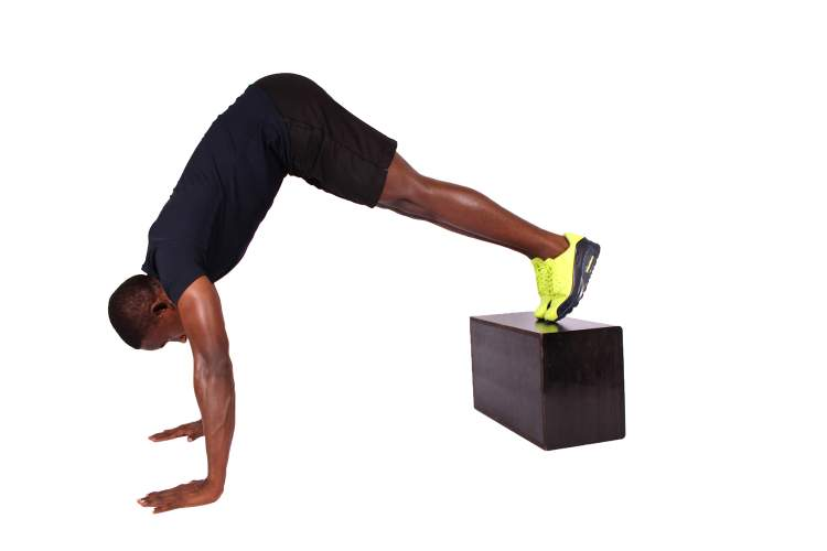 Pike push ups with elevated feet for shoulders.
