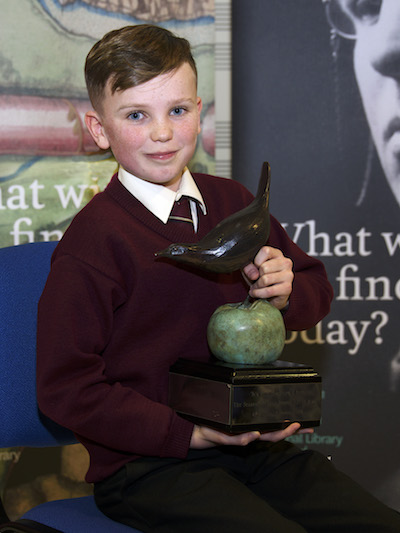 Last year's Junior Category Winner Brendan Mac Domhnaill of Coláiste Oiriall, Co. Monaghan, with the Poetry Aloud trophy.