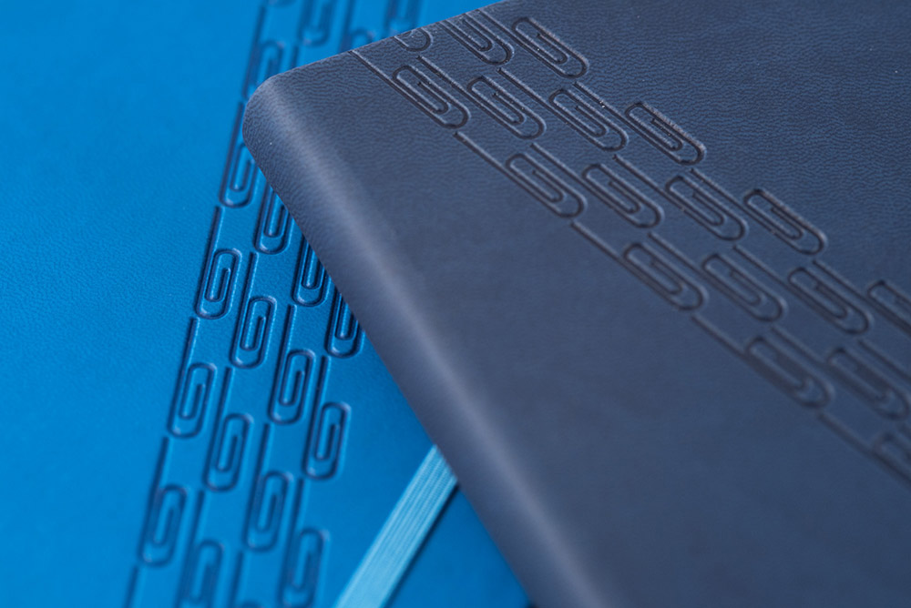 blue branded notebooks