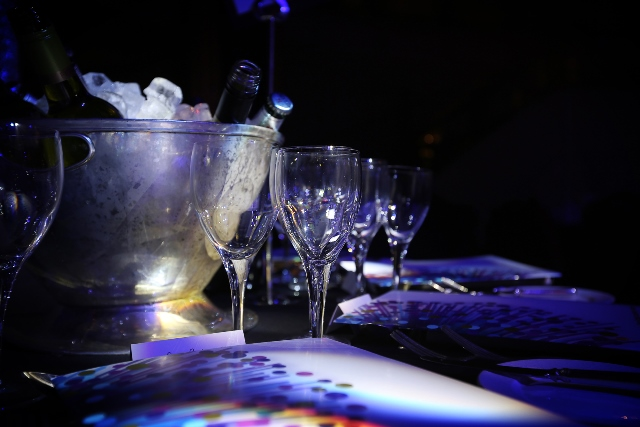 Champagne bucket, glasses and programme booklet on party table