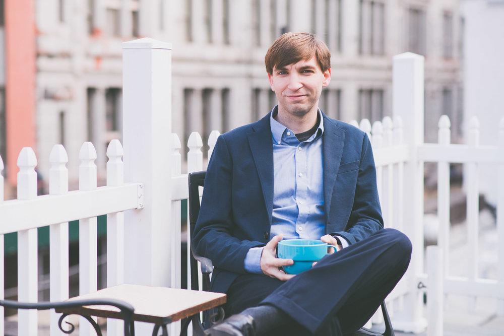 Man with coffee at work - Worklife portraits - Photo credit Nicola Bailey.jpg